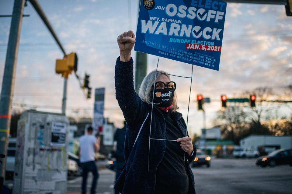 Georgia Senate Candidate Rev. Warnock Campaigns Day Before Runoff Election