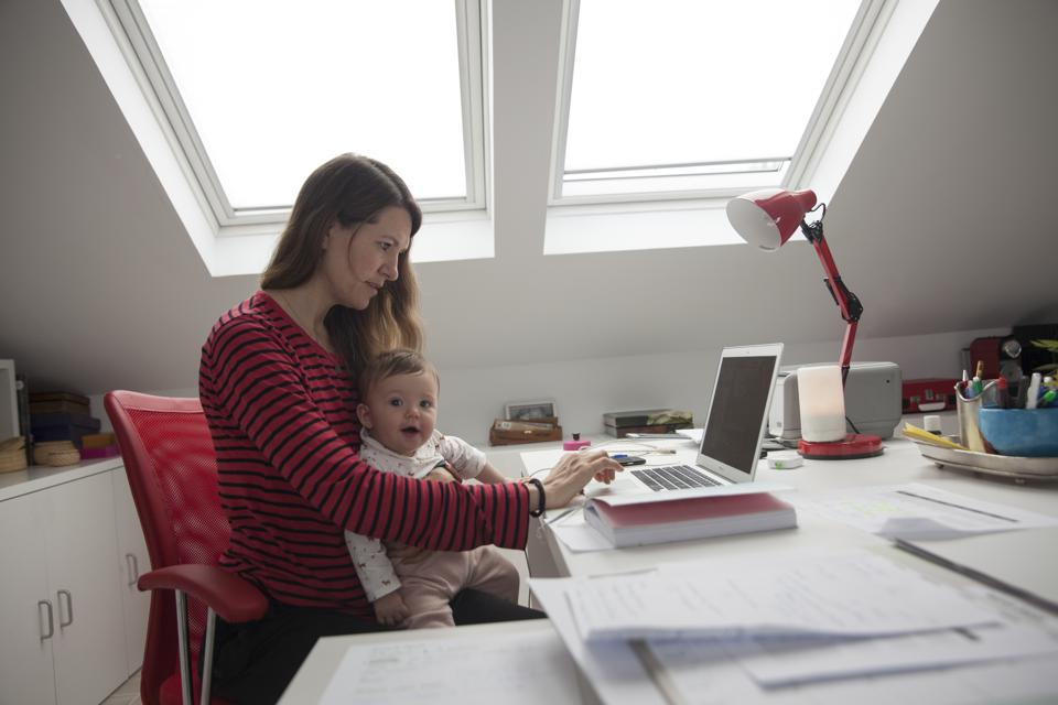 Working mothers may have to telecommute in order to balance work and family demands.