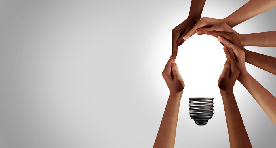 hands holding a light bulb symbolizing good ideas and lessons learned