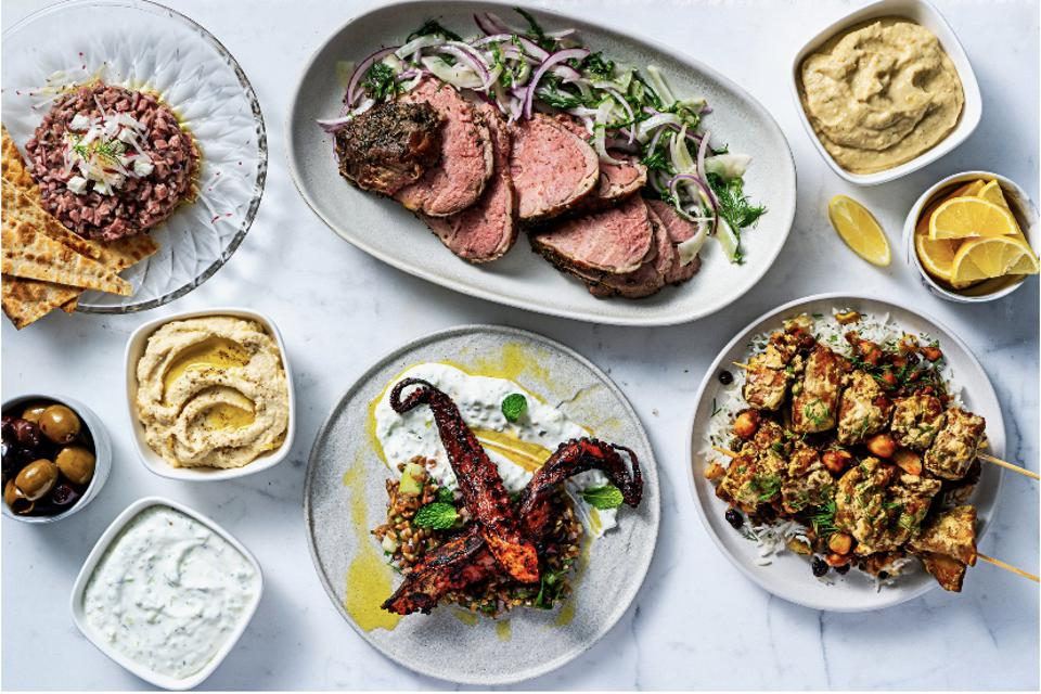 Mediterranean plates filled with hummus, lamb, octopus, and eggplant all sou vide options