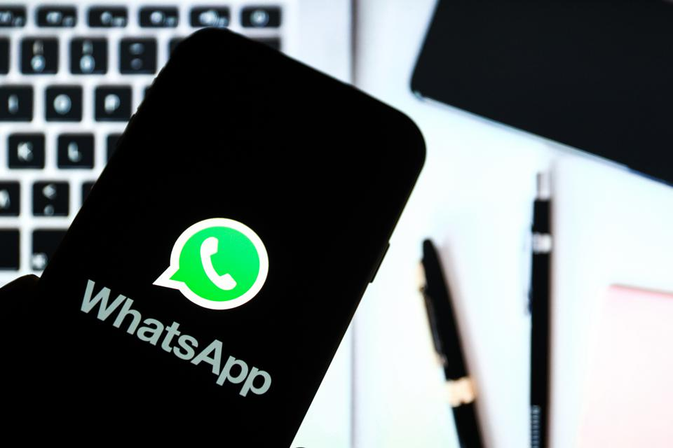 In this photo illustration a Whatsapp online communicator...