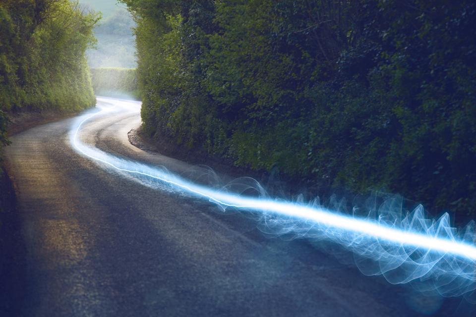 A blue fiber optic cable running down the countryside