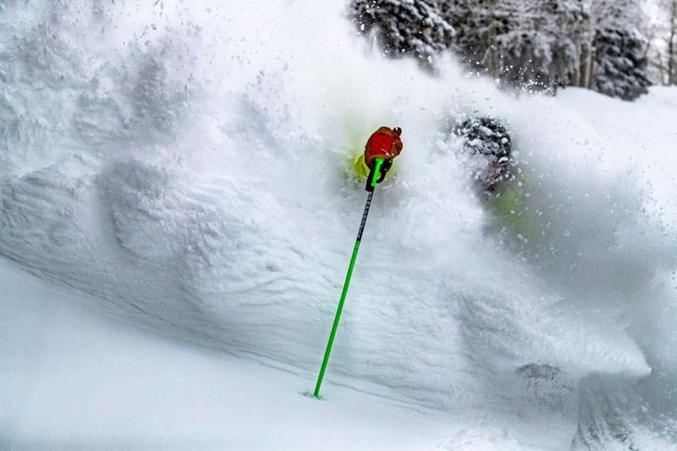 A skier in Colorado surrounded by mounds of powder.