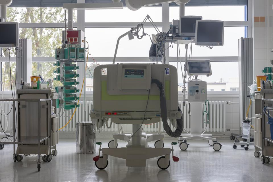 Intensive care unit in hospital, bed with monitors, ventilator, a place where can be  treated patients with pneumonia caused by coronavirus covid 19.