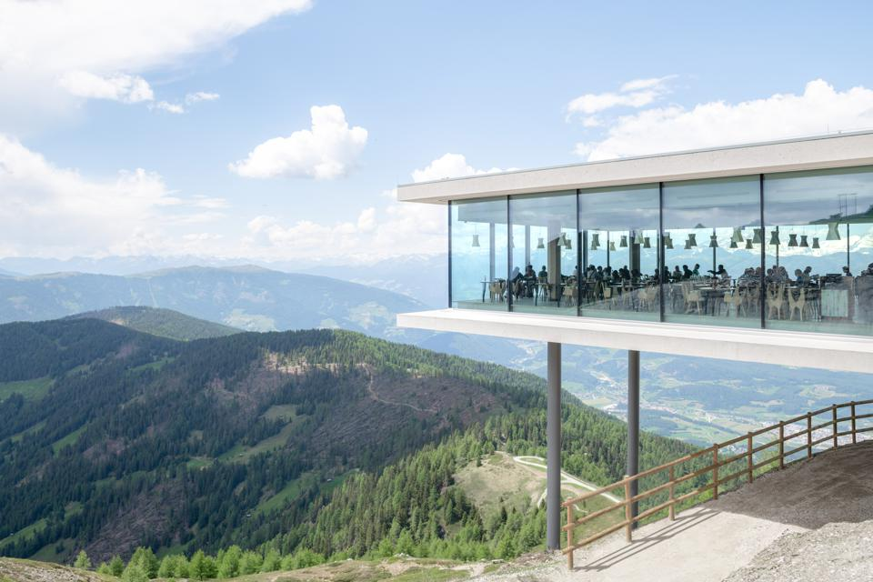 AlpINN restaurant hangs over the edge of a mountain in the Dolomites region of Italy