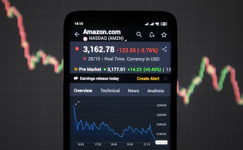 In this photo illustration an Amazon index displayed on a...