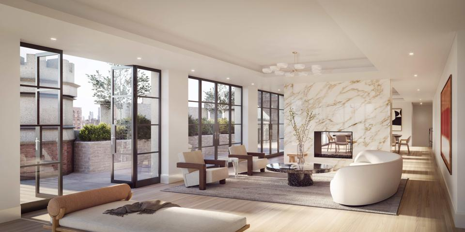 A living room with doors open to the wraparound terrace.