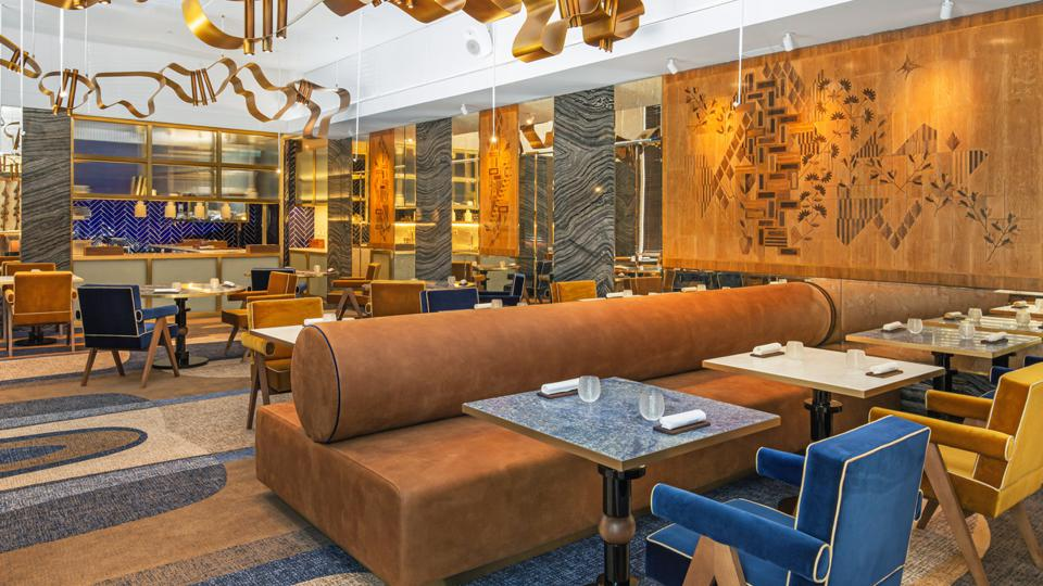 The dining room at Cura at the Four Seasons Hotel Ritz in Lisbon Portugal is elegant