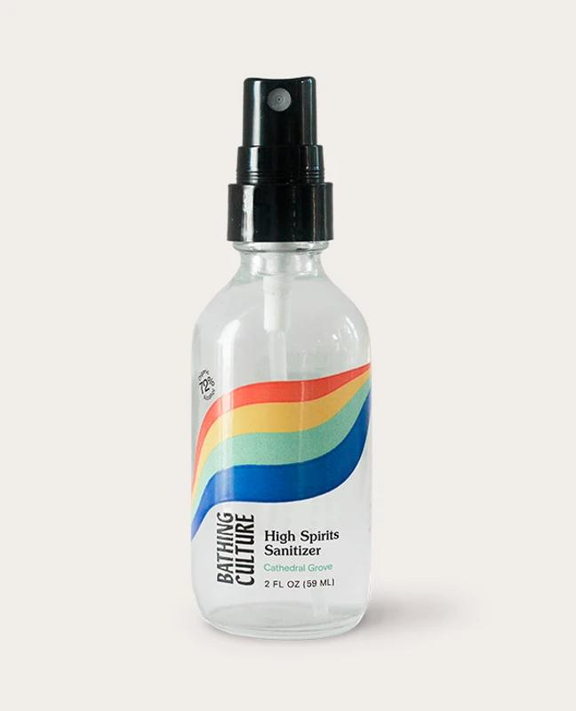 Clear Bathing Culture hand sanitizer spray bottle with rainbow package design.