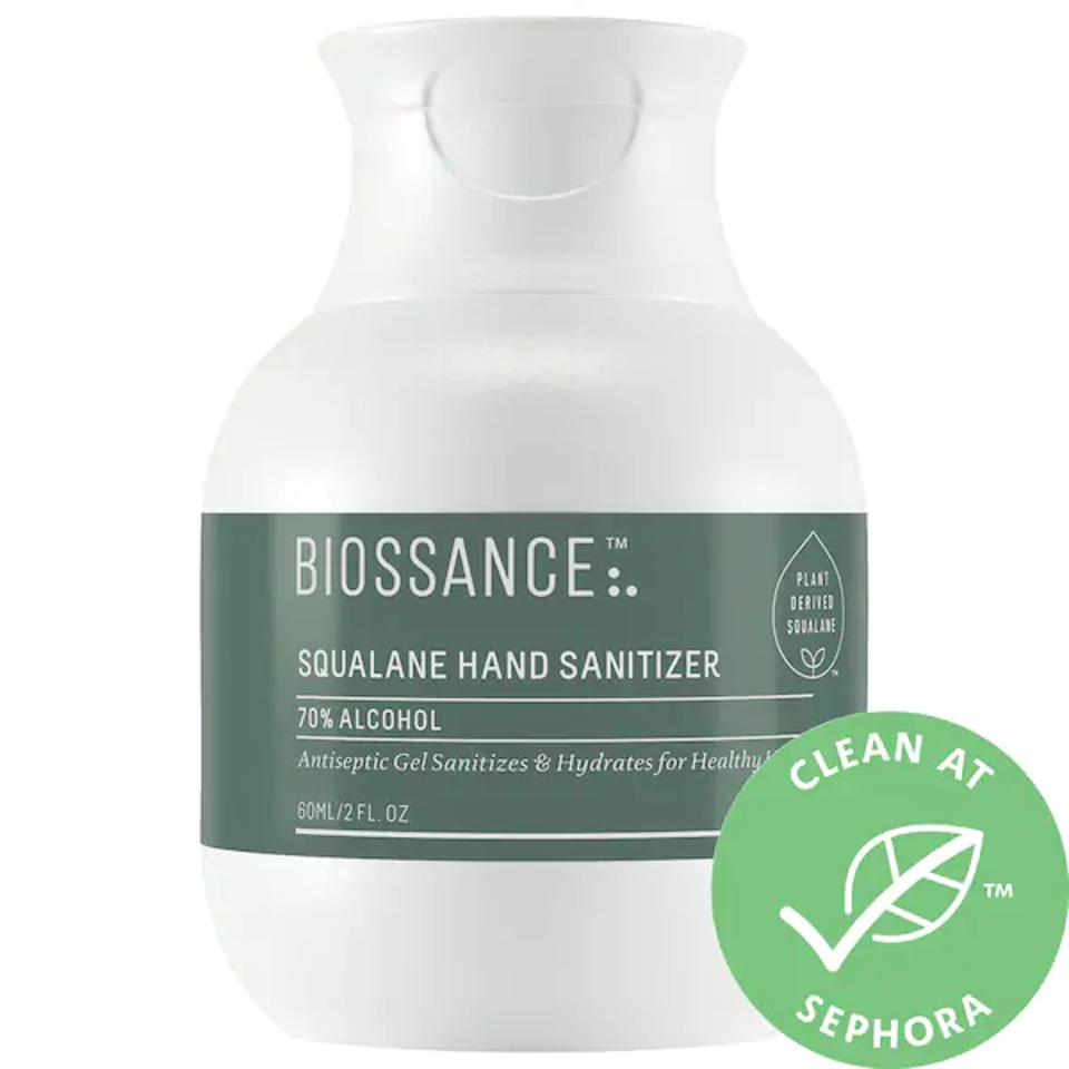 Mini green and white bottle of the Biossance hand sanitizer.