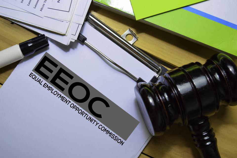 Equal Employment Opportunity Commission (EEOC) text on Document form and gavel isolated on office desk.