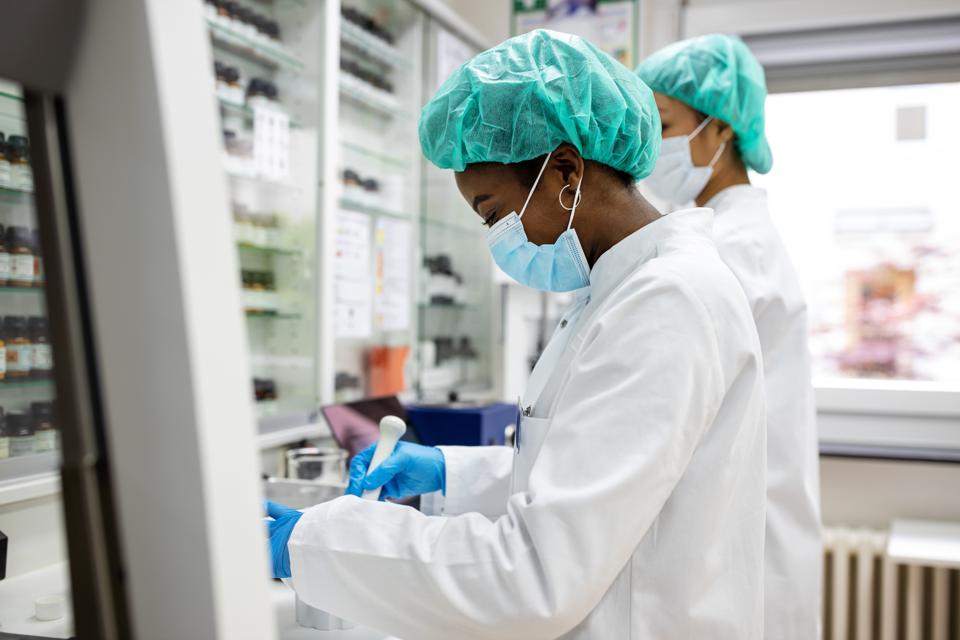 Chemist developing new medicine in laboratory