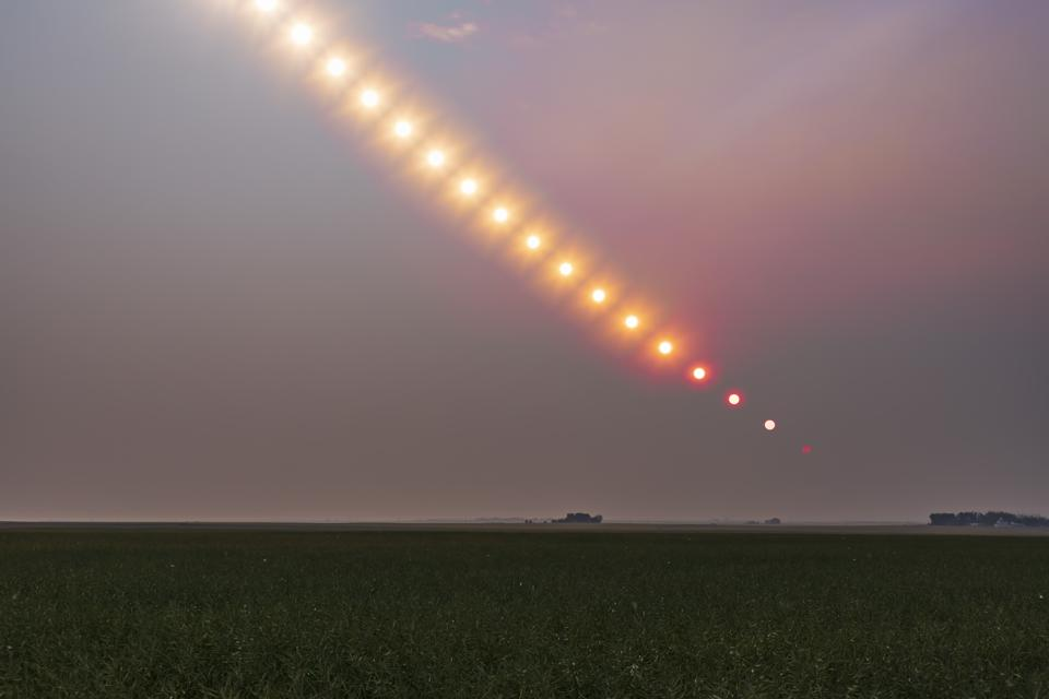 The Sun setting into a pall of forest fire smoke over Alberta from fires in BC and elsewhere