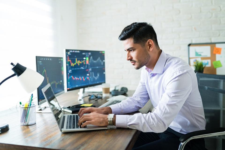 Finance businessman looking at data on laptop