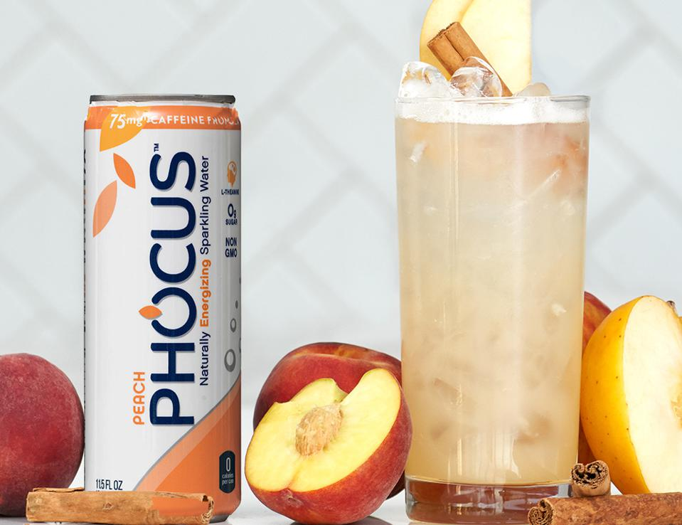 Can of Phocus sparkling water and cocktail glass