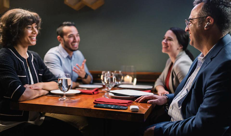 People sat at restaurant table