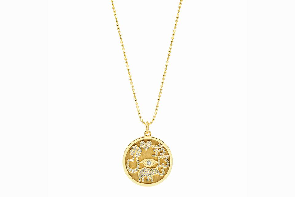 The designer's iconic Good Luck necklace includes seven good luck symbols
