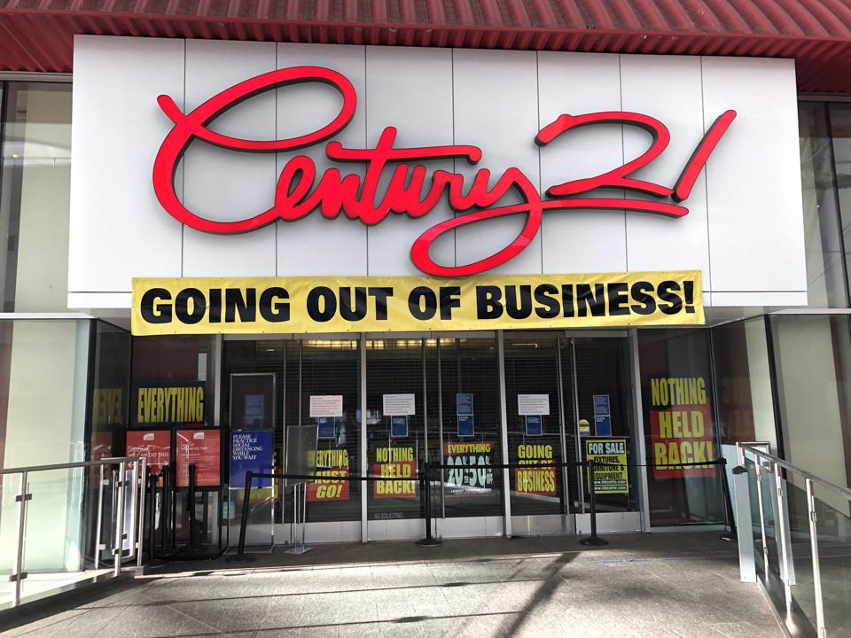 A Century 21 store at the Rego Park Mall in Queens, New York with ″Going Out off Business″ banners on the facade.