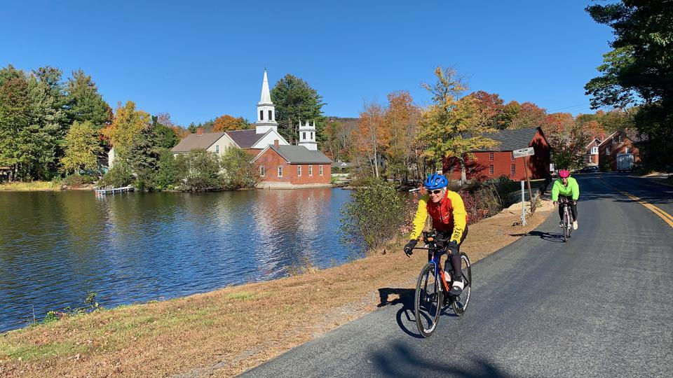 Cycling past a pond in Harrisville, New Hampshire