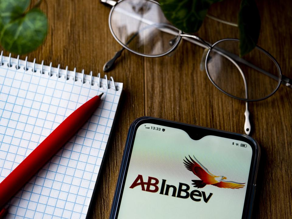 In this photo illustration an Anheuser-Busch InBev, logo is...