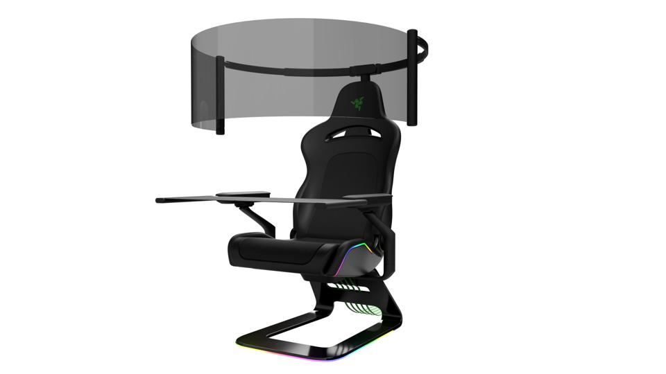 gaming chair with curved screen and armrest tables deployed