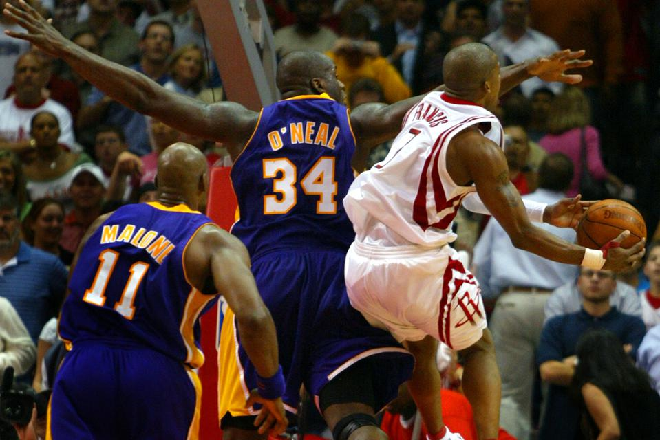 Houston Rocket Steve Francis scores over Laker Shaquille O'Neal late in the 4th quarter during Game
