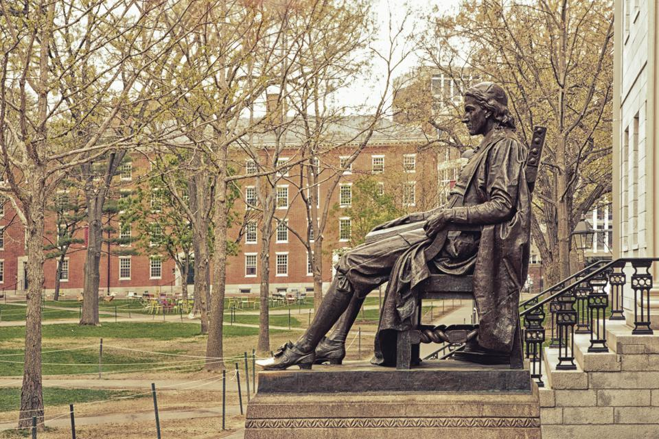 A profile view of the John Harvard Statue in Cambridge Ma