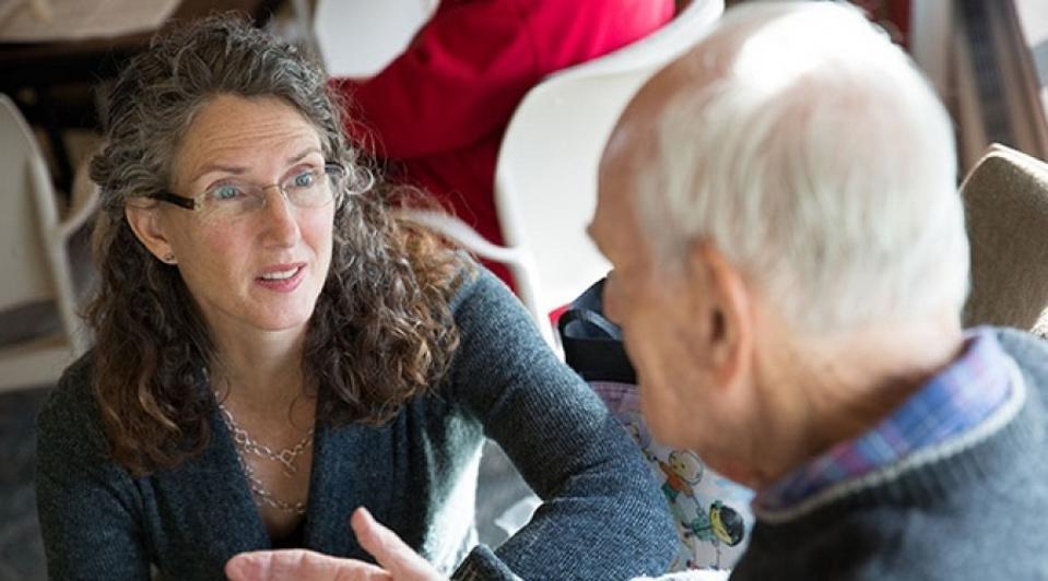 woman talking to man at nursing home