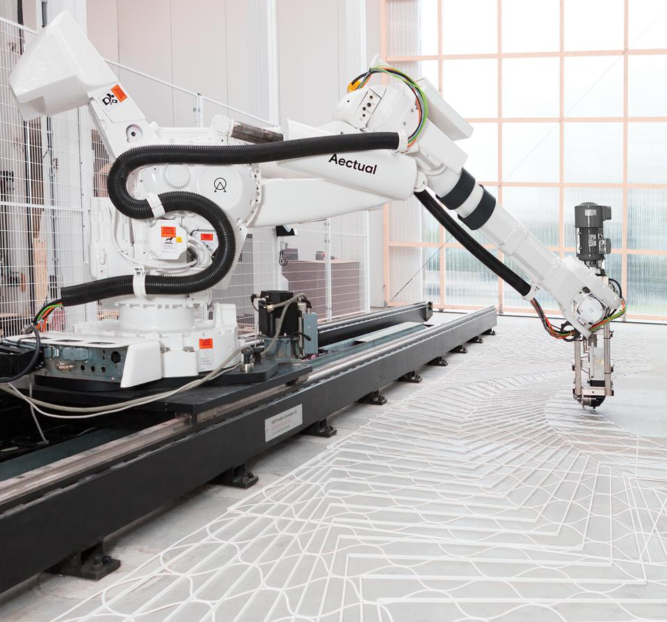 AECTUAL_XL 3D Printing Robot working on the floors at Schiphol Airport.