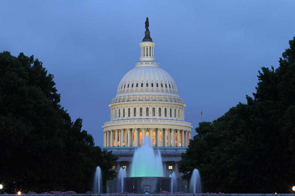 United States Capitol Building and Fountains at Twilight