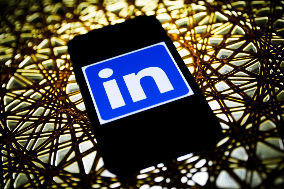 Cell phone with LinkedIn logo on it