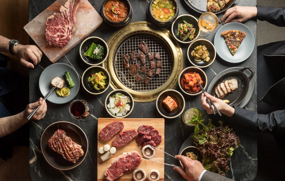 korean bbq, steak, banchan, laid out on a table with in New York City