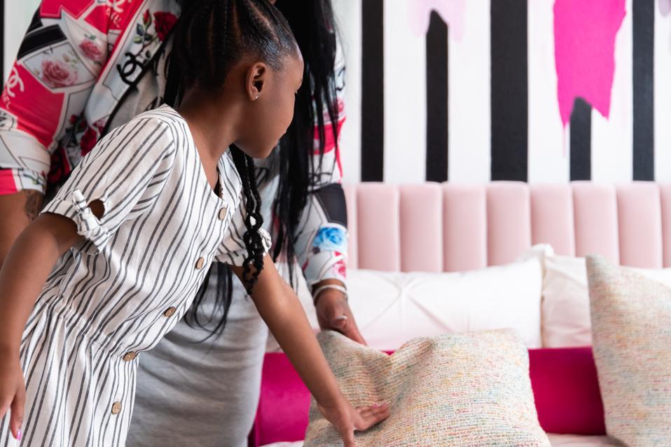 Gianna Floyd and Roxie Washington with the 'Gianna' LA Warm & Fuzzy pillow