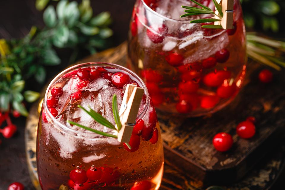 Festive Cranberry and rosemary cocktail with ice. Alcoholic or non-alcoholic cocktail