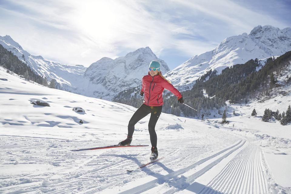 Austria, Tyrol, Luesens, Sellrain, cross-country skier in snow-covered landscape