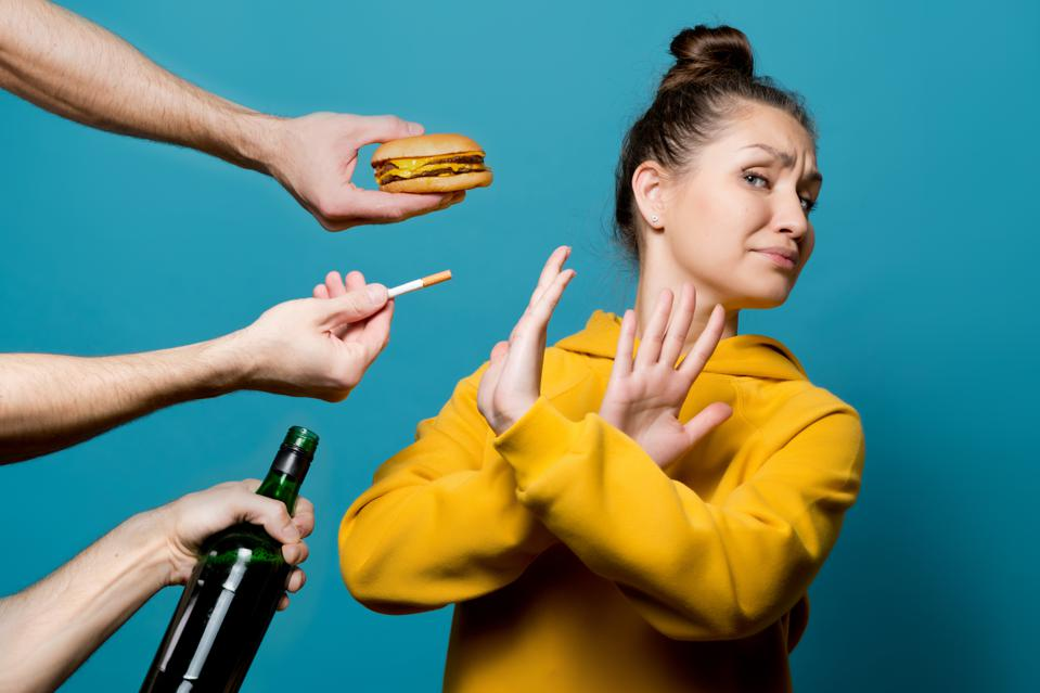 girl in bright clothes refuses junk food, alcohol and cigarettes
