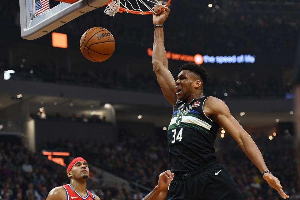 Giannis Antetokounmpo dunks against the Philadelphia 76ers during the first half of a game at Fiserv Forum on February 06, 2020 in Milwaukee, Wisconsin.