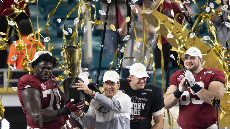 Alabama head coach Nick Saban holds the College Football National Championship trophy.