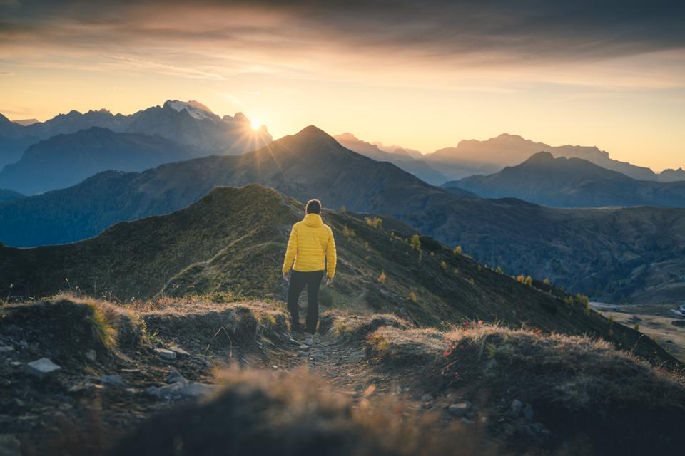 One person admiring the sunset on a mountain ridge, Italy