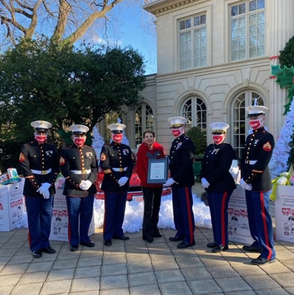 The Giving Joy - Toy Drive-Thru benefitted the Children's National Hospital and Toys for Tots.