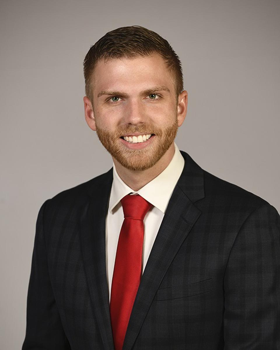 Portrait of young real estate agent Adam Olsen