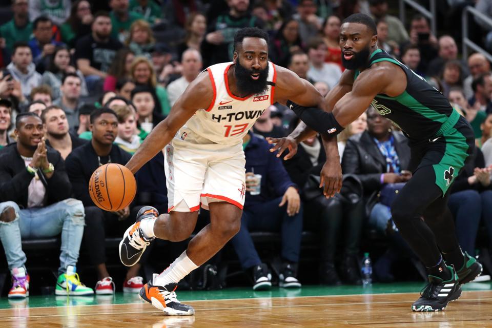 The Houston Rockets' James Harden vs Jaylen Brown in a game against the Boston Celtics.