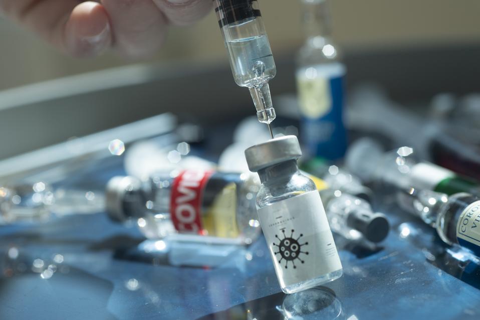 Covid-19 (coronavirus) and vaccine vial.