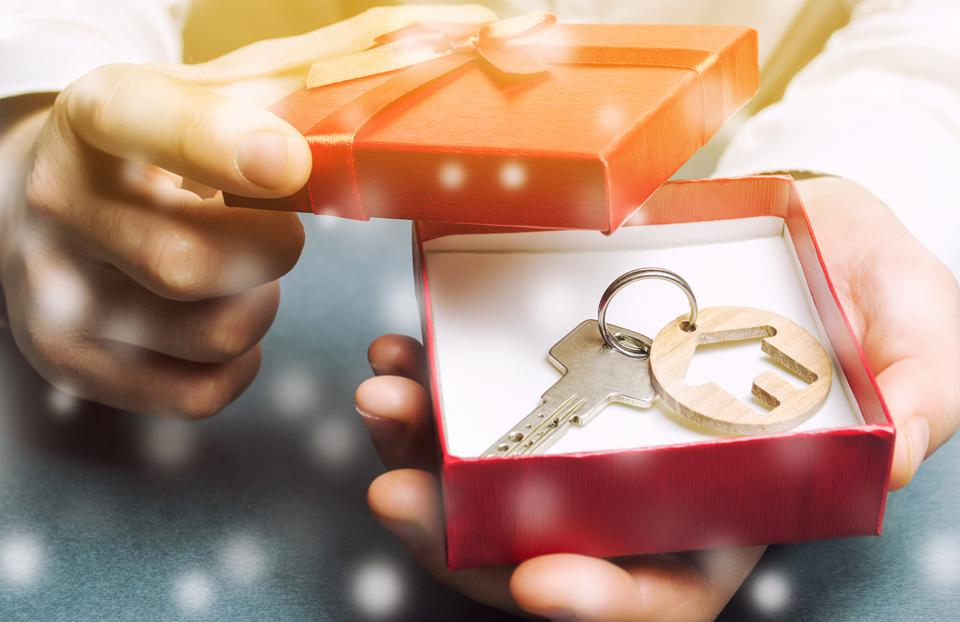 Keys with a house with a gift box and snow.