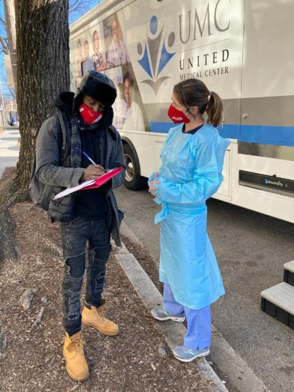 Nurse practitioner engages community member at a mobile healthcare van