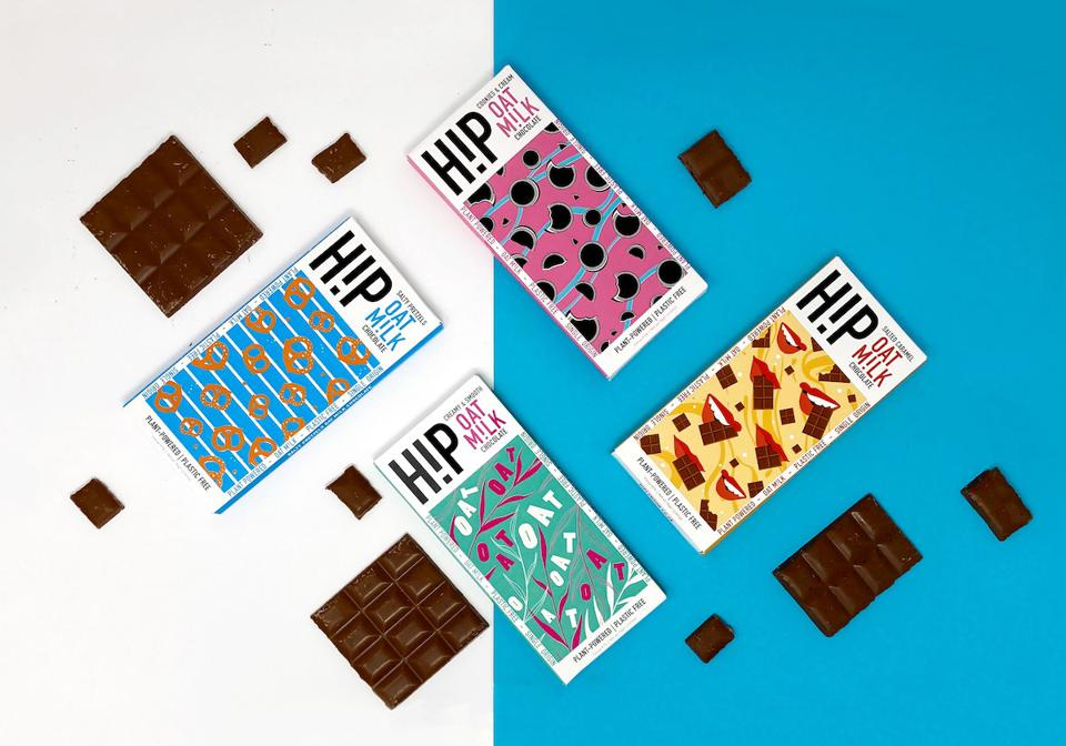 four chocolate bars in colorful packaging