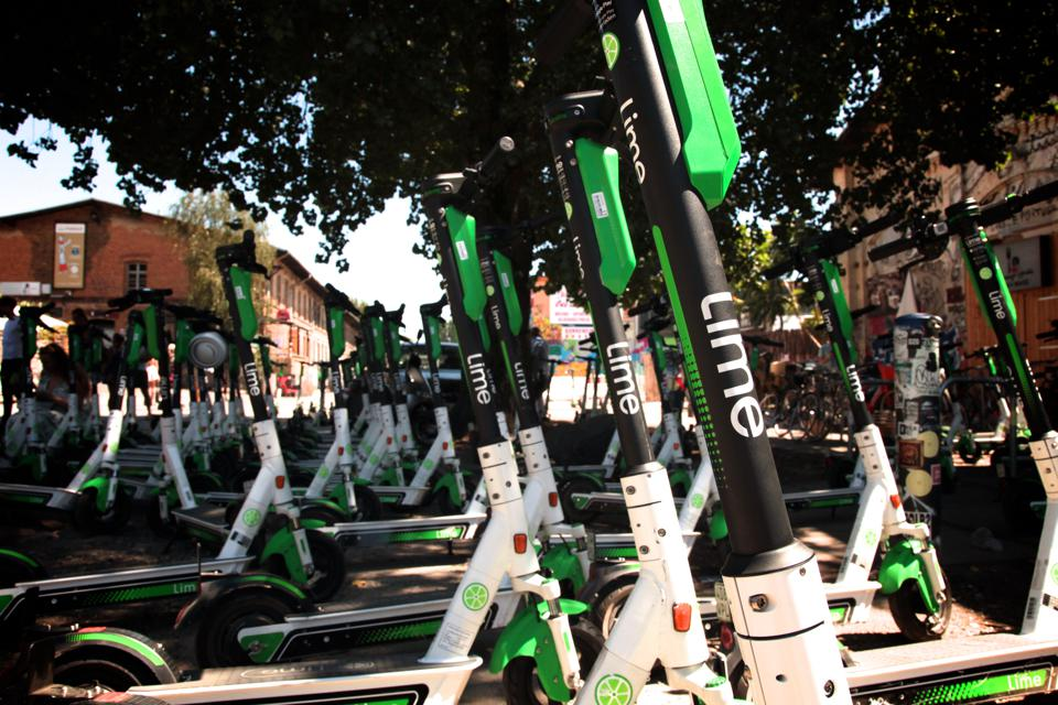 A picture of a number of Lime Scooters
