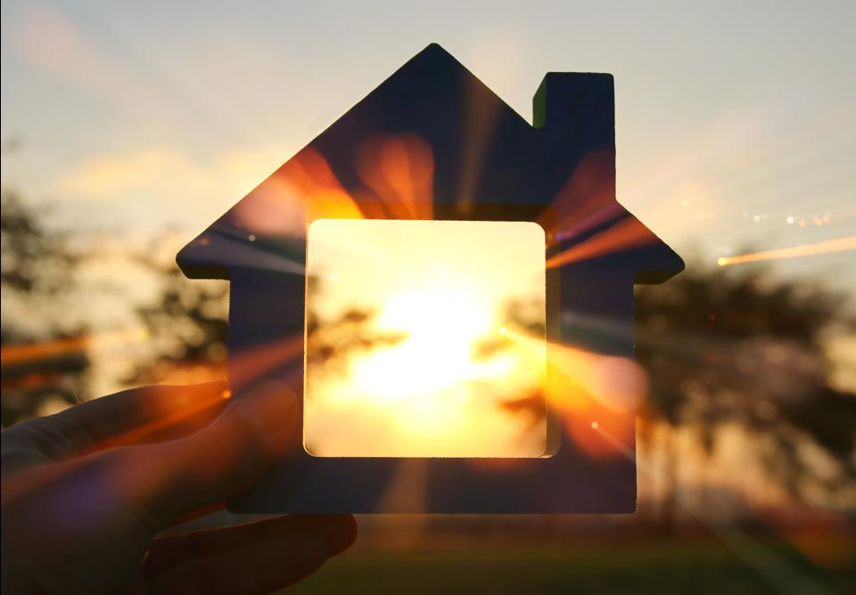 Abstract image of a house at sunset with light coming through it.