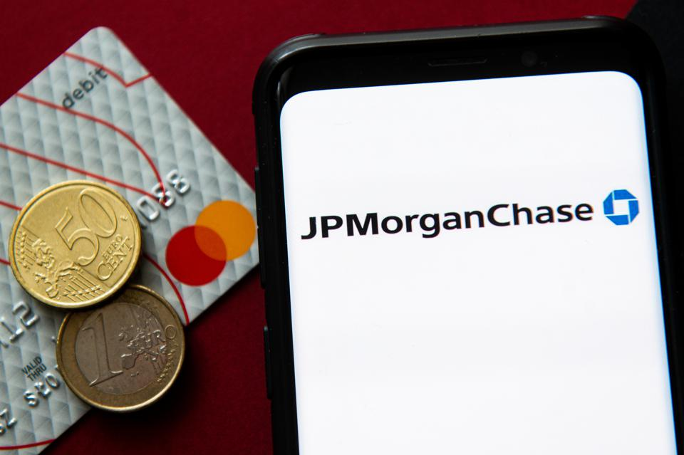 In this photo illustration a JP Morgan Chase logo seen...