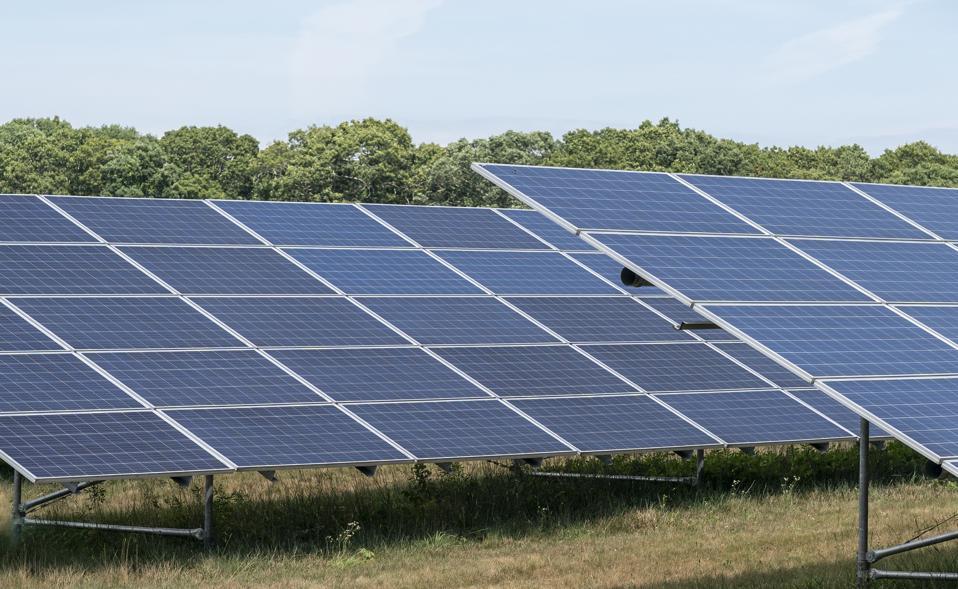 Solar photovoltaic power plant farm installation. Solar farm...